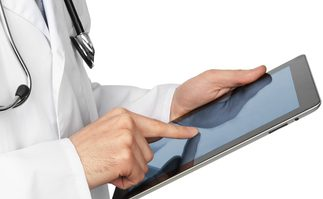 Doctor with tablet computer. Isolated over white background.